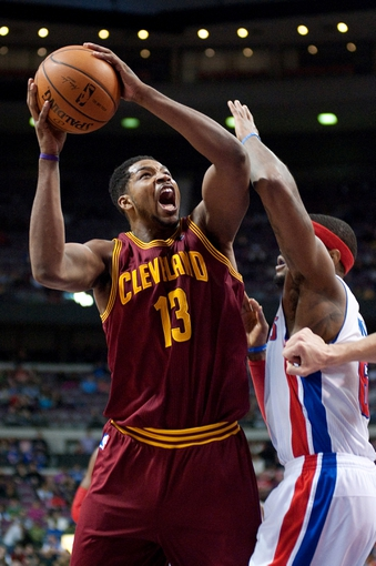 Mar 26, 2014; Auburn Hills, MI, USA; Cleveland Cavaliers forward Tristan Thompson (13) goes to the basket against Detroit Pistons forward Josh Smith (6) during the third quarter at The Palace of Auburn Hills. Cleveland won 97-96. Mandatory Credit: Tim Fuller-USA TODAY Sports
