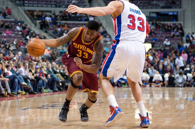 Mar 26, 2014; Auburn Hills, MI, USA; Cleveland Cavaliers forward Alonzo Gee (33) drives to the basket against Detroit Pistons forward Jonas Jerebko (33) during the fourth quarter at The Palace of Auburn Hills. Cleveland won 97-96. Mandatory Credit: Tim Fuller-USA TODAY Sports