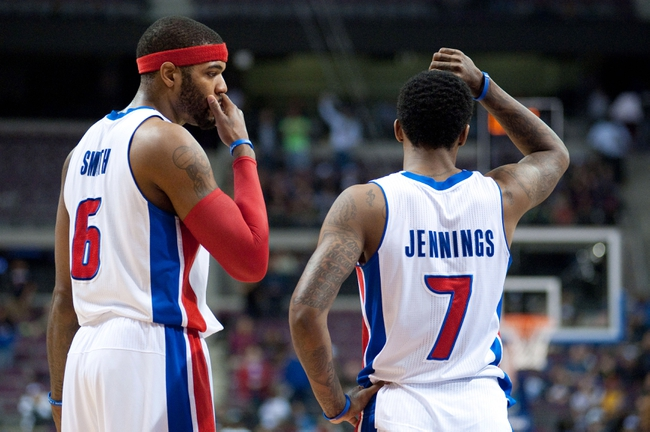 Mar 26, 2014; Auburn Hills, MI, USA; Detroit Pistons forward Josh Smith (6) talks with guard Brandon Jennings (7) during the fourth quarter against the Cleveland Cavaliers at The Palace of Auburn Hills. Cleveland won 97-96. Mandatory Credit: Tim