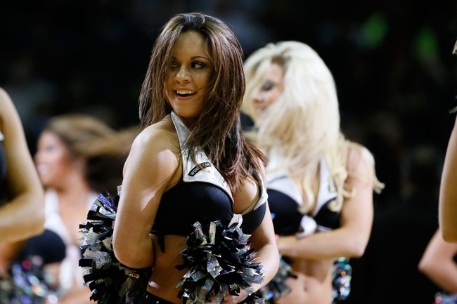 Mar 26, 2014; San Antonio, TX, USA; San Antonio Spurs cheerleader performs during the second half against the Denver Nuggets at AT&T Center. Mandatory Credit: Soobum Im-USA TODAY Sports