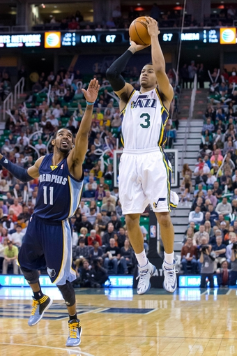 Mar 26, 2014; Salt Lake City, UT, USA; Utah Jazz guard Trey Burke (3) shoots against Memphis Grizzlies guard Mike Conley (11) during the second half at EnergySolutions Arena. The Grizzlies won 91-87. Mandatory Credit: Russ Isabella-USA TODAY Sports