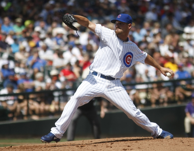 Mar 27, 2014; Mesa, AZ, USA; Chicago Cubs starting pitcher Travis Wood (37) throws in the first inning against the Chicago White Sox at HoHoKam Park. Mandatory Credit: Rick Scuteri-USA TODAY Sports