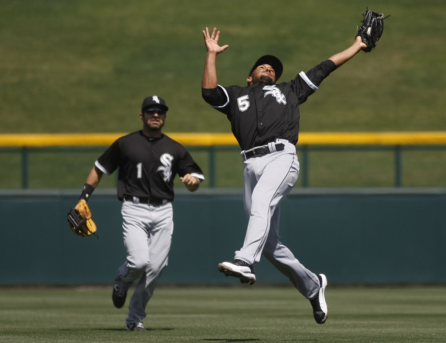 Mar 27, 2014; Mesa, AZ, USA; Chicago White Sox shortstop Marcus Semien (5) makes the off balance catch in front of left fielder Adam Eaton (1) in the third inning against the Chicago Cubs at HoHoKam Park. Mandatory Credit: Rick Scuteri-USA TODAY Sports