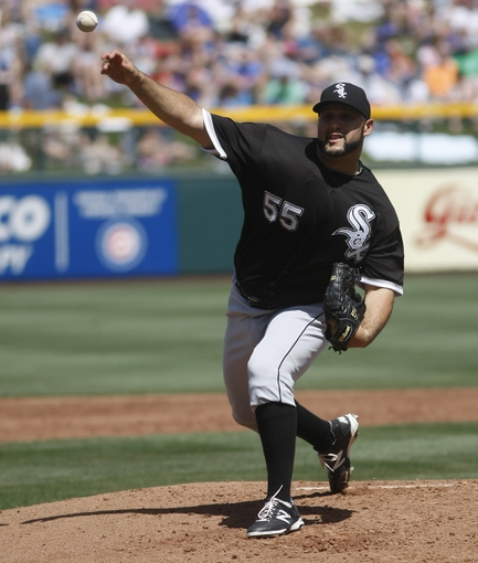Mar 27, 2014; Mesa, AZ, USA; Chicago White Sox starting pitcher Felipe Paulino (55) throws in the first inning against the Chicago Cubs at HoHoKam Park. Mandatory Credit: Rick Scuteri-USA TODAY Sports