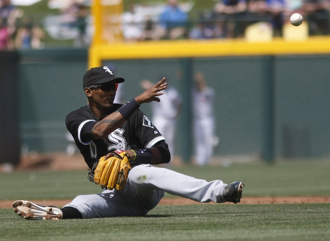 Mar 27, 2014; Mesa, AZ, USA; Chicago White Sox shortstop Alexei Ramirez (10) flips the ball for the out against the Chicago Cubs in the fourth inning at HoHoKam Park. Mandatory Credit: Rick Scuteri-USA TODAY Sports