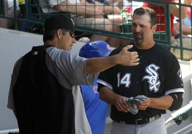 Mar 27, 2014; Mesa, AZ, USA; Chicago White Sox first baseman Paul Konerko (14) talks to manager Robin Ventura (23) after grounding out in the fourth inning against the Chicago Cubs at HoHoKam Park. Mandatory Credit: Rick Scuteri-USA TODAY Sports