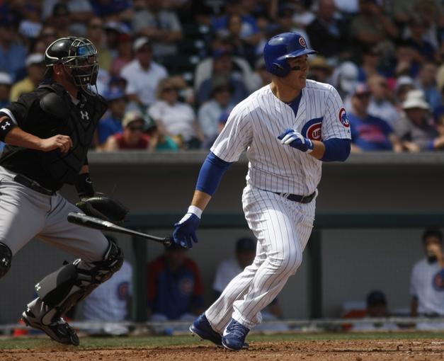 Mar 27, 2014; Mesa, AZ, USA; Chicago Cubs first baseman Anthony Rizzo (44) hits in the fifth inning against the Chicago White Sox at HoHoKam Park. Mandatory Credit: Rick Scuteri-USA TODAY Sports