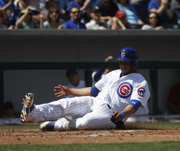 Mar 27, 2014; Mesa, AZ, USA; Chicago Cubs catcher Welington Castillo (5) scores in the fourth inning against the Chicago White Sox at HoHoKam Park. Mandatory Credit: Rick Scuteri-USA TODAY Sports