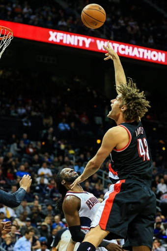 Mar 27, 2014; Atlanta, GA, USA; Portland Trail Blazers center Robin Lopez (42) shoots the ball in the first quarter against the Atlanta Hawks at Philips Arena. Mandatory Credit: Daniel Shirey-USA TODAY Sports