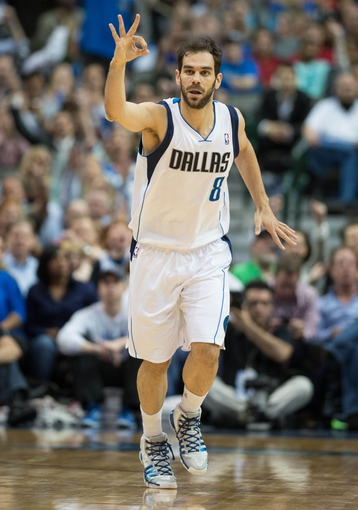 Mar 27, 2014; Dallas, TX, USA; Dallas Mavericks guard Jose Calderon (8) celebrates after scoring against the Los Angeles Clippers during the second half at the American Airlines Center. The Clippers won 109-103. Mandatory Credit: Jerome Miron-USA TODAY Sports