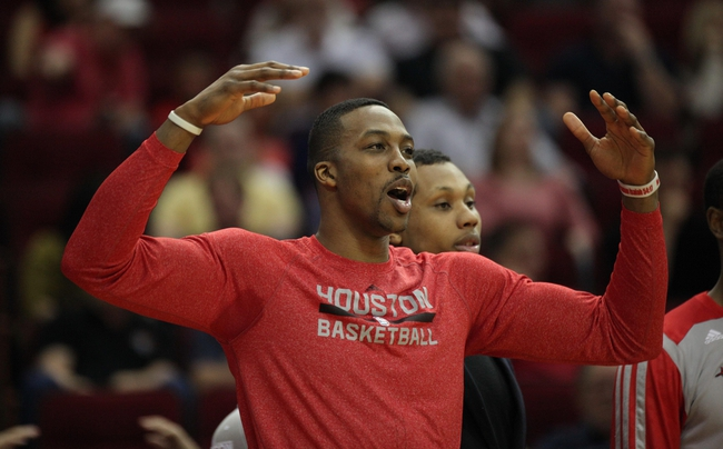 Mar 20, 2014; Houston, TX, USA; Houston Rockets center Dwight Howard (12) reacts to a play during the fourth quarter against the Minnesota Timberwolves at Toyota Center. Mandatory Credit: Andrew Richardson-USA TODAY Sports
