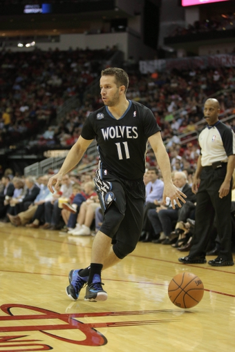 Mar 20, 2014; Houston, TX, USA; Minnesota Timberwolves guard J.J. Barea (11) drives to the basket during the fourth quarter against the Houston Rockets at Toyota Center. Mandatory Credit: Andrew Richardson-USA TODAY Sports