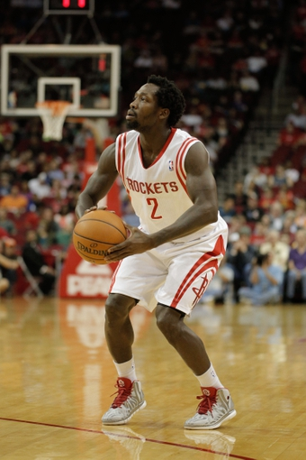 Mar 20, 2014; Houston, TX, USA; Houston Rockets guard Patrick Beverley (2) shoots the ball during the second quarter against the Minnesota Timberwolves at Toyota Center. Mandatory Credit: Andrew Richardson-USA TODAY Sports