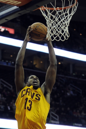 Mar 22, 2014; Cleveland, OH, USA; Cleveland Cavaliers forward Tristan Thompson (13)  against the Houston Rockets at Quicken Loans Arena. Houston won 118-111. Mandatory Credit: Ken Blaze-USA TODAY Sports