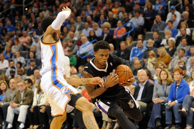 Mar 28, 2014; Oklahoma City, OK, USA; Sacramento Kings guard Ben McLemore (16) drives to the basket against Oklahoma City Thunder guard Jeremy Lamb (11) during the first quarter at Chesapeake Energy Arena. Mandatory Credit: Mark D. Smith-USA TODAY Sports