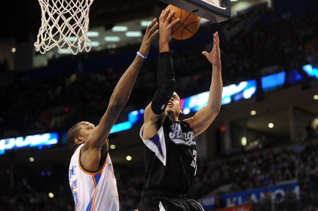 Mar 28, 2014; Oklahoma City, OK, USA; Sacramento Kings guard Ray McCallum (3) attempts a shot against Oklahoma City Thunder forward Kevin Durant (35) during the first quarter at Chesapeake Energy Arena. Mandatory Credit: Mark D. Smith-USA TODAY Sports