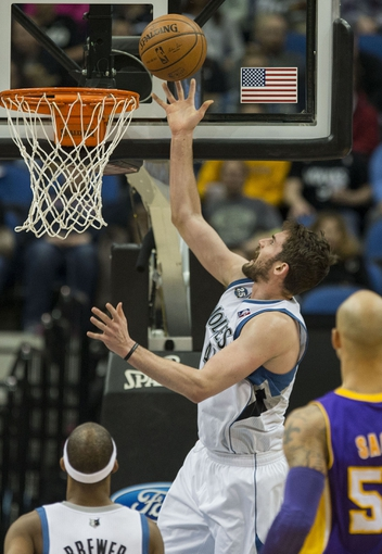 Mar 28, 2014; Minneapolis, MN, USA; Minnesota Timberwolves forward Kevin Love (42) shoots the ball in the first half against the Los Angeles Lakers at Target Center. Mandatory Credit: Jesse Johnson-USA TODAY Sports