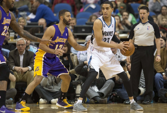 Mar 28, 2014; Minneapolis, MN, USA; Minnesota Timberwolves guard Kevin Martin (23) holds the ball in front of Los Angeles Lakers guard Kendall Marshall (12) in the first half at Target Center. Mandatory Credit: Jesse Johnson-USA TODAY Sports