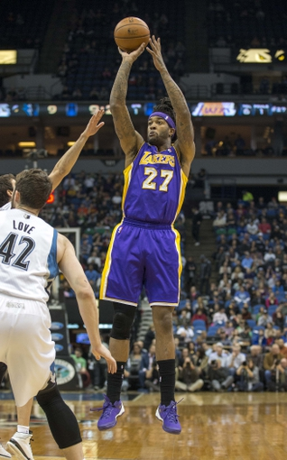 Mar 28, 2014; Minneapolis, MN, USA; Los Angeles Lakers forward Jordan Hill (27) shoots the ball over in the first half against the Minnesota Timberwolves at Target Center. Mandatory Credit: Jesse Johnson-USA TODAY Sports