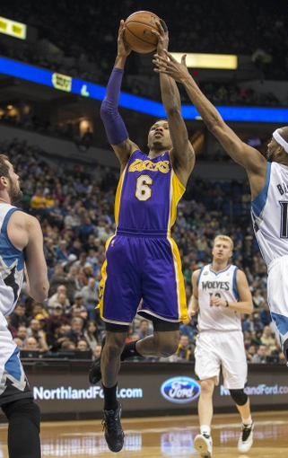 Mar 28, 2014; Minneapolis, MN, USA; Los Angeles Lakers guard Kent Bazemore (6) shoots the ball against the Minnesota Timberwolves at Target Center. Mandatory Credit: Jesse Johnson-USA TODAY Sports
