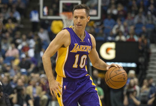 Mar 28, 2014; Minneapolis, MN, USA; Los Angeles Lakers guard Steve Nash (10) dribbles the ball against the Minnesota Timberwolves in the first half at Target Center. Mandatory Credit: Jesse Johnson-USA TODAY Sports