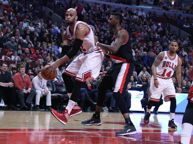Mar 28, 2014; Chicago, IL, USA; Chicago Bulls forward Taj Gibson (22) drives past Portland Trail Blazers forward Dorell Wright (1) during the second quarter at the United Center. Mandatory Credit: Dennis Wierzbicki-USA TODAY Sports