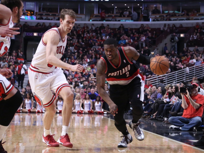Mar 28, 2014; Chicago, IL, USA; Portland Trail Blazers guard Wesley Matthews (2) drives past Chicago Bulls forward Mike Dunleavy (34) during the second quarter at the United Center. Mandatory Credit: Dennis Wierzbicki-USA TODAY Sports