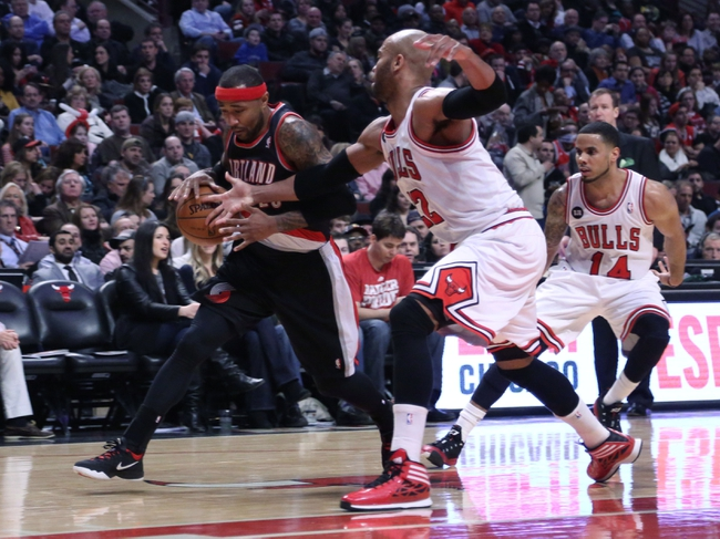 Mar 28, 2014; Chicago, IL, USA; Portland Trail Blazers guard Mo Williams (25) drives past Chicago Bulls forward Taj Gibson (22) during the second quarter at the United Center. Mandatory Credit: Dennis Wierzbicki-USA TODAY Sports