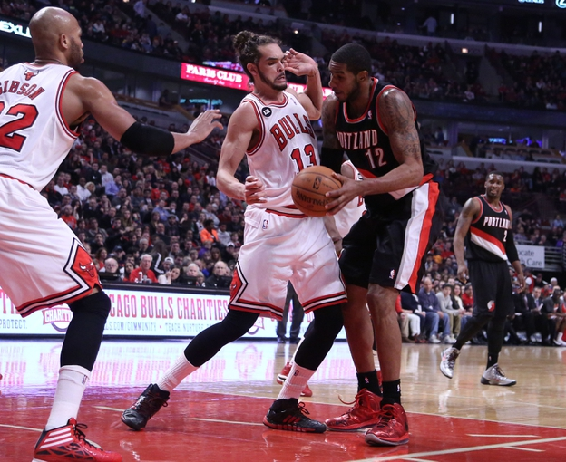 Mar 28, 2014; Chicago, IL, USA; Chicago Bulls center Joakim Noah (13) and Portland Trail Blazers forward LaMarcus Aldridge (12) fight for the ball during the second quarter at the United Center. Mandatory Credit: Dennis Wierzbicki-USA TODAY Sports