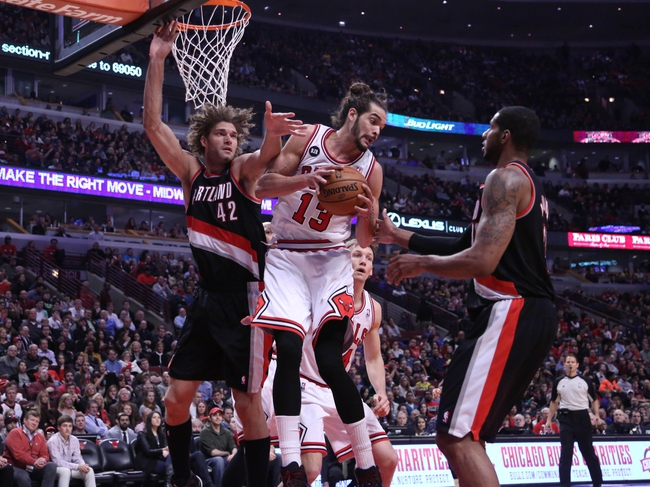 Mar 28, 2014; Chicago, IL, USA; Chicago Bulls center Joakim Noah (center) rebounds between Portland Trail Blazers center Robin Lopez (left) and forward LaMarcus Aldridge (right) during the second quarter at the United Center. Mandatory Credit: Dennis Wierzbicki-USA TODAY Sports