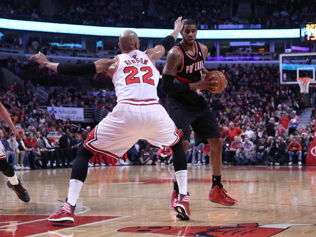Mar 28, 2014; Chicago, IL, USA; Portland Trail Blazers forward Dorell Wright (1) being defended by Chicago Bulls forward Mike Dunleavy (34) during the second quarter at the United Center. Mandatory Credit: Dennis Wierzbicki-USA TODAY Sports