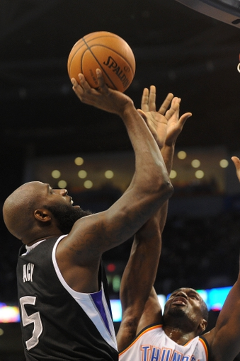 Mar 28, 2014; Oklahoma City, OK, USA; Sacramento Kings forward Quincy Acy (5) attempts a shot against Oklahoma City Thunder forward Serge Ibaka (9) during the second quarter at Chesapeake Energy Arena. Mandatory Credit: Mark D. Smith-USA TODAY Sports