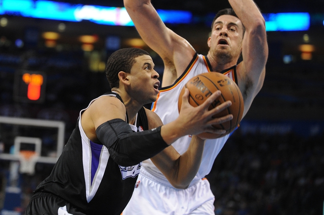 Mar 28, 2014; Oklahoma City, OK, USA; Sacramento Kings guard Ray McCallum (3) handles the ball against Oklahoma City Thunder forward Nick Collison (4) during the second quarter at Chesapeake Energy Arena. Mandatory Credit: Mark D. Smith-USA TODAY Sports