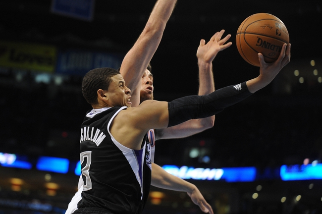 Mar 28, 2014; Oklahoma City, OK, USA; Sacramento Kings guard Ray McCallum (3) attempts a shot against Oklahoma City Thunder forward Nick Collison (4) during the second quarter at Chesapeake Energy Arena. Mandatory Credit: Mark D. Smith-USA TODAY Sports