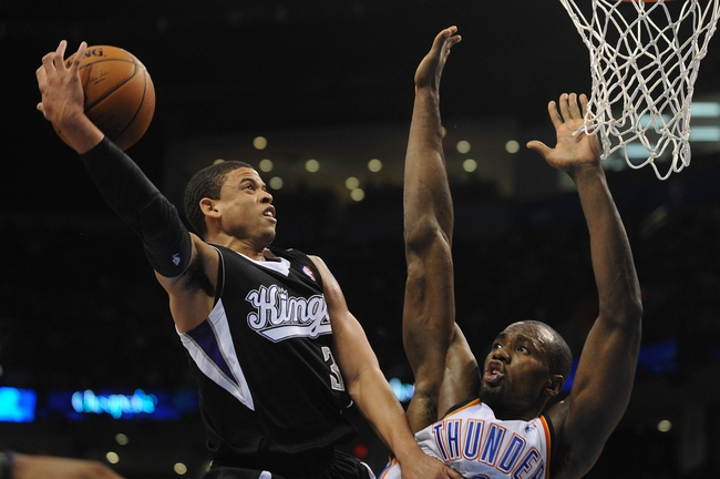 Mar 28, 2014; Oklahoma City, OK, USA; Sacramento Kings guard Ray McCallum (3) attempts to dunk the ball against Oklahoma City Thunder forward Serge Ibaka (9) during the second quarter at Chesapeake Energy Arena. Mandatory Credit: Mark D. Smith-USA TODAY Sports