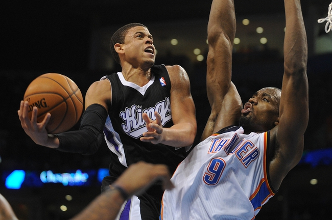 Mar 28, 2014; Oklahoma City, OK, USA; Sacramento Kings guard Ray McCallum (3) attempts a shot against Oklahoma City Thunder forward Serge Ibaka (9) during the second quarter at Chesapeake Energy Arena. Mandatory Credit: Mark D. Smith-USA TODAY Sports