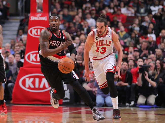 Mar 28, 2014; Chicago, IL, USA; Portland Trail Blazers guard Wesley Matthews (2) runs past Chicago Bulls center Joakim Noah (13) during the second quarter at the United Center. Mandatory Credit: Dennis Wierzbicki-USA TODAY Sports