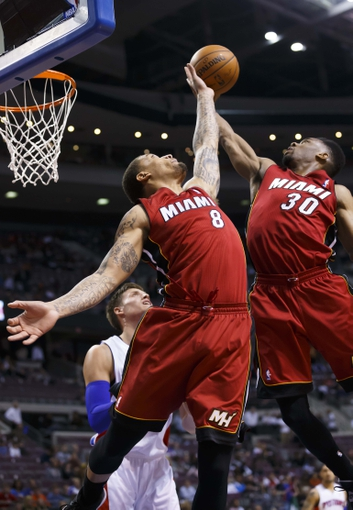 Mar 28, 2014; Auburn Hills, MI, USA; Miami Heat forward Michael Beasley (8) and guard Norris Cole (30) goes for the rebound in the fourth quarter against the Detroit Pistons at The Palace of Auburn Hills. Mandatory Credit: Rick Osentoski-USA TODAY Sports