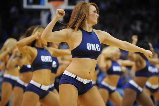 Mar 28, 2014; Oklahoma City, OK, USA; Members of the Oklahoma City Thunder dance team entertain the fans in a break in action against the Sacramento Kings at Chesapeake Energy Arena. Mandatory Credit: Mark D. Smith-USA TODAY Sports