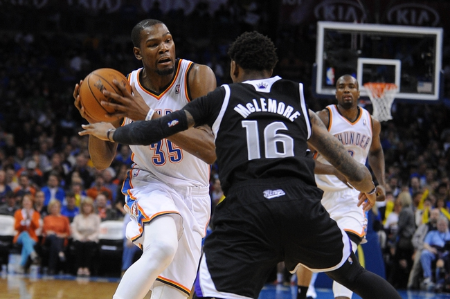 Mar 28, 2014; Oklahoma City, OK, USA; Oklahoma City Thunder forward Kevin Durant (35) drives to the basket against Sacramento Kings guard Ben McLemore (16) during the third quarter at Chesapeake Energy Arena. Mandatory Credit: Mark D. Smith-USA TODAY Sports