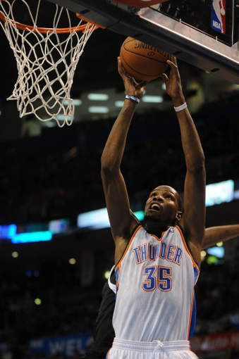 Mar 28, 2014; Oklahoma City, OK, USA; Oklahoma City Thunder forward Kevin Durant (35) attempts a shot against Sacramento Kings forward Rudy Gay (8) during the third quarter at Chesapeake Energy Arena. Mandatory Credit: Mark D. Smith-USA TODAY Sports