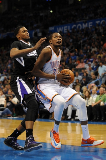 Mar 28, 2014; Oklahoma City, OK, USA; Oklahoma City Thunder forward Kevin Durant (35) drives to the basket against Sacramento Kings forward Rudy Gay (8) during the third quarter at Chesapeake Energy Arena. Mandatory Credit: Mark D. Smith-USA TODAY Sports