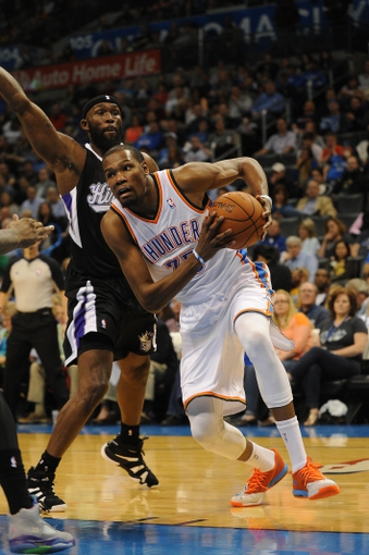 Mar 28, 2014; Oklahoma City, OK, USA; Oklahoma City Thunder forward Kevin Durant (35) drives to the basket against Sacramento Kings forward Quincy Acy (5) during the third quarter at Chesapeake Energy Arena. Mandatory Credit: Mark D. Smith-USA TODAY Sports