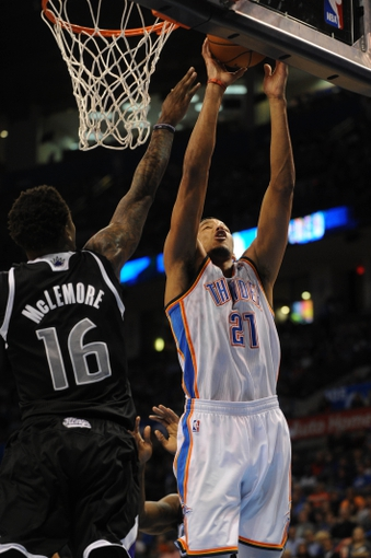 Mar 28, 2014; Oklahoma City, OK, USA; Oklahoma City Thunder guard Andre Roberson (21) attempts a shot against Sacramento Kings guard Ben McLemore (16) during the third quarter at Chesapeake Energy Arena. Mandatory Credit: Mark D. Smith-USA TODAY Sports