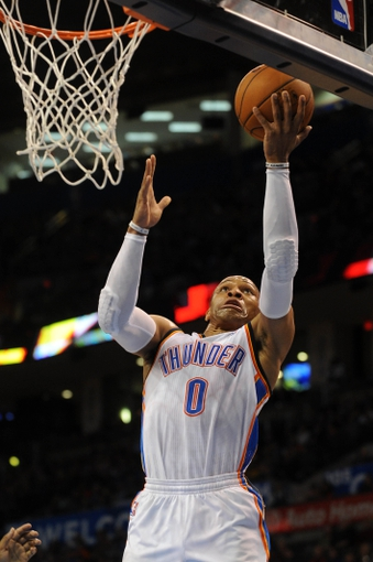 Mar 28, 2014; Oklahoma City, OK, USA; Oklahoma City Thunder guard Russell Westbrook (0) attempts a shot against the Sacramento Kings during the third quarter at Chesapeake Energy Arena. Mandatory Credit: Mark D. Smith-USA TODAY Sports