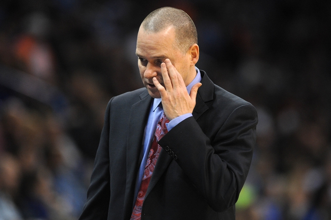 Mar 28, 2014; Oklahoma City, OK, USA; Sacramento Kings head coach Michael Malone reacts to a play in action against the Sacramento Kings at Chesapeake Energy Arena. Mandatory Credit: Mark D. Smith-USA TODAY Sports