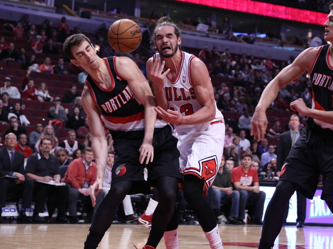 Mar 28, 2014; Chicago, IL, USA; Portland Trail Blazers forward Victor Claver (18) and Chicago Bulls center Joakim Noah (13) fight for the ball during the second half at the United Center. Portland won 91-74. Mandatory Credit: Dennis Wierzbicki-USA TODAY Sports