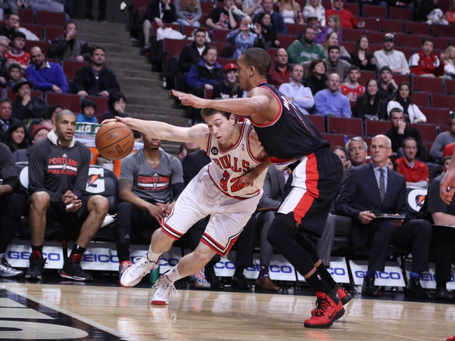Mar 28, 2014; Chicago, IL, USA; Chicago Bulls guard Jimmer Fredette (32) is defended by Portland Trail Blazers guard C.J. McCollum (3) during the second half at the United Center. Portland won 91-74. Mandatory Credit: Dennis Wierzbicki-USA TODAY Sports