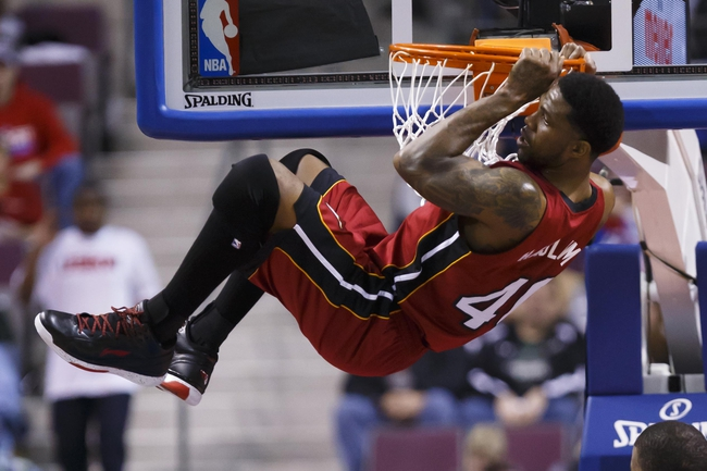 Mar 28, 2014; Auburn Hills, MI, USA; Miami Heat forward Udonis Haslem (40) hangs on the net after dunking in the second half against the Detroit Pistons at The Palace of Auburn Hills. Miami won 110-78. Mandatory Credit: Rick Osentoski-USA TODAY Sports