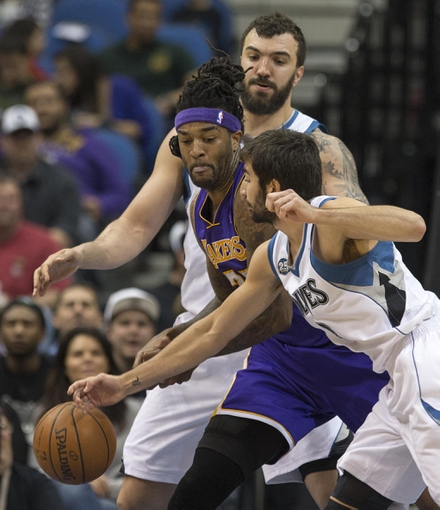 Mar 28, 2014; Minneapolis, MN, USA; Minnesota Timberwolves guard Ricky Rubio (9) attempts to steal the ball from Los Angeles Lakers forward Jordan Hill (27) in the second half at Target Center. The Timberwolves won 143-107. Mandatory Credit: Jesse Johnson-USA TODAY Sports
